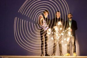 Stylised light play photo of Unbroken Trio